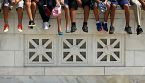 Children taking part in the Tragedy Assistance Program for Survivors (TAPS) pose for a group photo in the amphitheater at Arlington National Cemetery in Arlington, Virginia. TAPS invited 40 children from the Israel Defense Forces Widows and Orphans Organization (IDFWO) and 15 children of American service members who have died to Good Grief Camp, an opportunity to learn coping skills and develop friendships and support systems.Photograph: Win McNamee/Getty Images