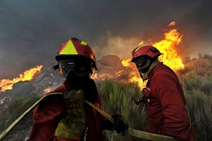 Firemen fight a forest fire at Seizures, near Penalva do Castelo, Portugal. Around 180 firemen are working to control the fire. Photograph: Nuno Andre Ferreira/EPA