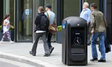 People walk past a 'spy bin' in the City of London