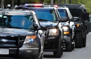 """A motorcade carrying James """"Whitey"""" Bulger departs the Moakley Federal Courthouse in Boston. A jury found Bulger guilty on several counts of murder, racketeering and conspiracy. Photograph: Charles Krupa/AP"""