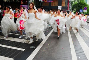 China Valentine's day: Women in wedding gowns participate in a brides' race event organized by a s