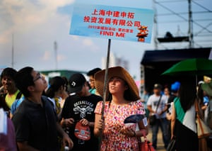 China Valentine's day: A woman holds a sign during a matchmaking event in Jinshan beach, south of