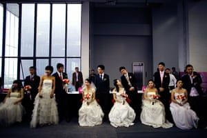 China Valentine's day: Couples wait to participate in a staged mass wedding, organised as part of