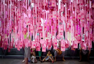 China Valentine's day: A child sits under message of love hanging at a shopping mall in Beijing, C