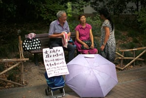 China Valentine's day: The parents of a person who is looking for a spouse, display a sign with th