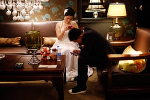 China Valentine's day: A couple waits to participate in a staged mass wedding, organised as part o