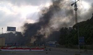Smoke rises from Rabaa al-Adwiya square in Cairo