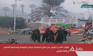 An image grab from Egyptian state TV shows police forces moving in to disperse a huge protest camp set up outside the Rabaa al-Adawiya mosque in Cairo.
