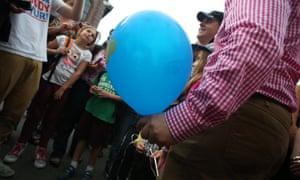 """The Prime Minister Kevin Rudd accidentally takes an LNP balloon from a boy who offered it to him during a tour of the Brisbane Show know locally as """"The Ekka"""" in Brisbane."""