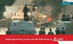 A bulldozer demolishes a barricade at a protest camp set up by supporters of deposed Egyptian President Mohamed Morsi in Cairo.