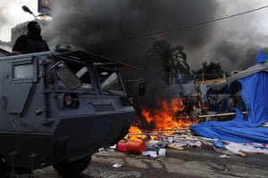 Egyptian camps: Egyptian security forces move in to disperse a protest camp near Cairo's Ra