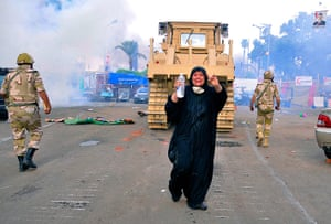 Egyptian camps: An Egyptian woman shouts as security forces move in with a bulldozer, at Na