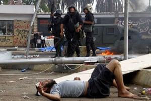 Egyptian camps: An injured man lies on the ground near Cairo's Rabaa al-Adawiya mosque