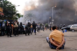 Egyptian camps: A handcuffed protester sits on the ground at a huge camp in Cairo's Al-Nahd
