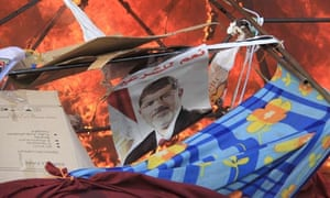 Flames at the Rabaa al-Adawiya camp in Cairo as security forces moved in to clear Morsi supporters