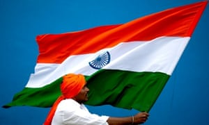 A man holds an Indian flag at Freedom Park in Bangalore. The country celebrates its Independence Day tomorrow.