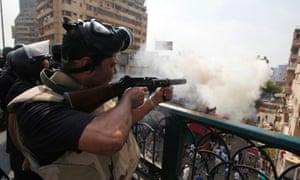 Riot police fire teargas during clashes with members of the Muslim Brotherhood and supporters of deposed Egyptian President Mohamed Morsi, around Cairo University and Nahdet Misr Square