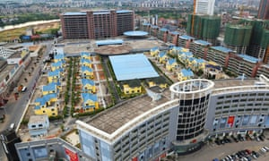 Live-work … a series of 25 villas on the roof of a shopping mall in Hengyang provide housing for migrant workers.