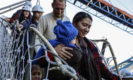 Hannah Gastonguay disembarks in Chile with her baby Rabah, daughter Ardith and husband Sean.