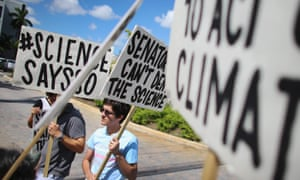 MIAMI, FL - AUGUST 13:  Alexius Marcano  and other protesters gather near the office of U.S. Sen. Marco Rubio