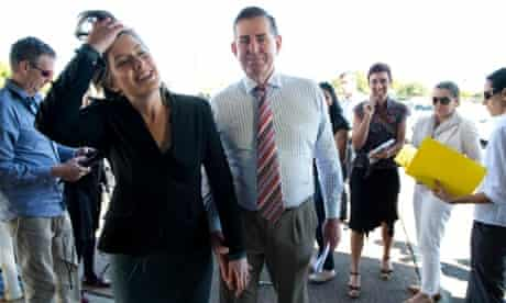 Sunshine Coast MP Peter Slipper and wife Inge (left) leave a press conference outside his electoral office on the Sunshine Coast, Thursday, Aug. 15, 2013.
