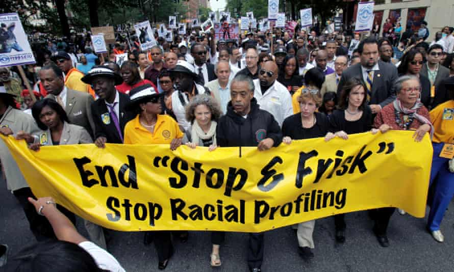 """The Reverend Al Sharpton walks with demonstrators during a silent march to end New York's """"stop-and-frisk"""" program. A US District Court judge has ruled that the New York Police Department deliberately violated the civil rights of tens of thousands of New Yorkers."""