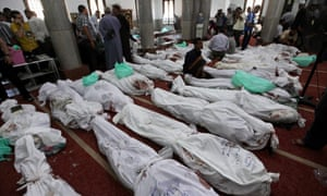 The bodies of protesters who died in clashes the day before are laid out at al-Iman mosque, Cairo, Egypt, 15 August 2013.