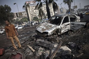 Egypt after crackdown: A man stands amid the debris at Rabaa al-Adawiya square