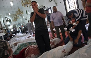 Egypt after crackdown: Egyptians mourn over the bodies of their relatives in the el-Iman mosque at Nasr City, Cairo