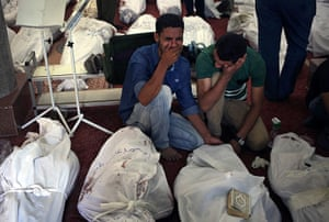 Egypt after crackdown: Egyptians mourn over the bodies of their relatives in the el-Iman mosque in Nasr City, Cairo