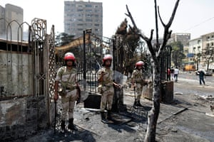 Egypt after crackdown: Soldiers stand guard outside the Rabaa al-Adawiya mosque