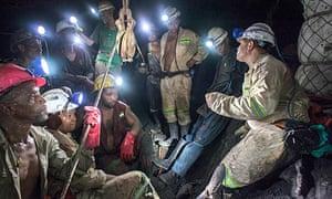 A team of miners gathers to start the shift at Marikana