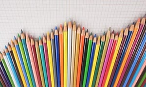 Several colored pencils lined up forming a graph.