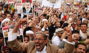 Supporters of Egypt's deposed Islamist President Mohamed Mursi shout slogans during a rally in protest of the recent violence in Egypt, in Sanaa August 16, 2013.
