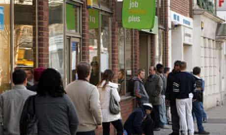 Jobseekers queue outside a Jobcentre Plus branch
