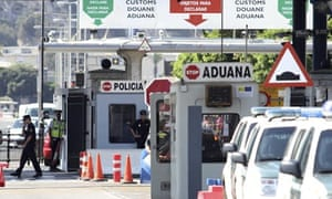 The Spanish police border post (front) and Gibraltar's border post