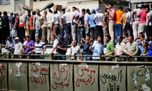 Protesters participate in a rally in Ramsis Square in Cairo on Friday.