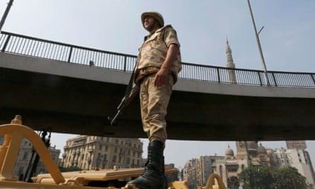 A soldier outside Ramses Square near al-Fath mosque in Cairo