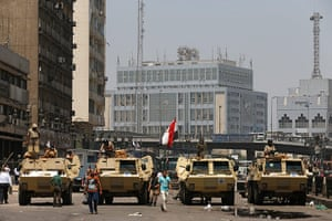 Egypt: Soldiers stand guard on armoured personnel carriers