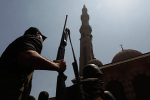 Egypt: Armed Egyptian policeman moves into position