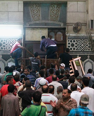 Egypt: Demonstrators wait by the barricaded door inside the mosque