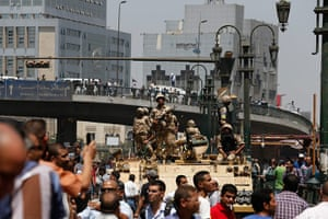 Egypt: Soldiers stand guard on an armoured personnel carrier