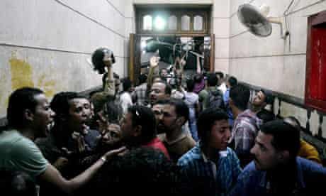 Security forces escort Muslim Brotherhood supporters away from the al-Fath mosque
