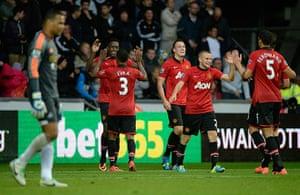 Swansea v United: United celebrate the 4th goal scored by Welbeck