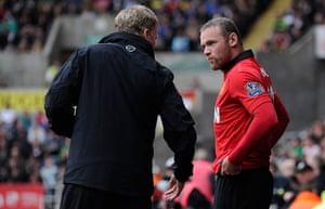 Swansea v United: David Moyes talks to Wayne Rooney as he brings him on as a substitute