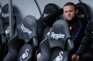 Swansea v United: Wayne Rooney doesn't look too happy sat on the bench