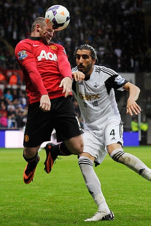 Swansea v United: Wayne Rooney's face contorts as he wins a header