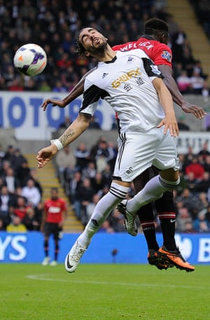Swansea v United: Chico Flores and Danny Welbeck compete