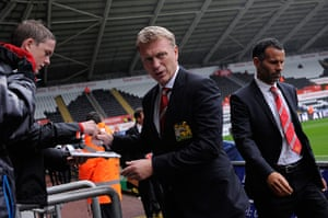 Swansea v United: David Moyes signs an autograph as he walks into the ground