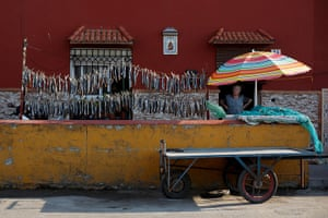 Gibraltar protests: A woman dries fish outside her home near Atunara Port in Linea de la Concep